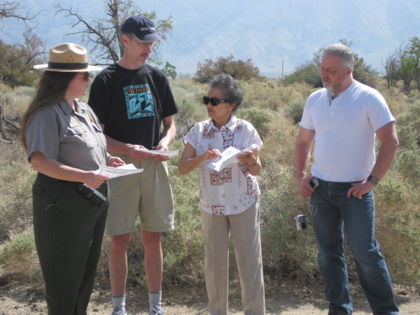 Bainbridge Island and former Manzanar internee, Kay Sakai Nakao talks with Alisa Lynch of the National Park Service at the site of the Sakai family barracks, with Wilkes Elementary Teachers, Bill Covert and Warren Read looking on.�
