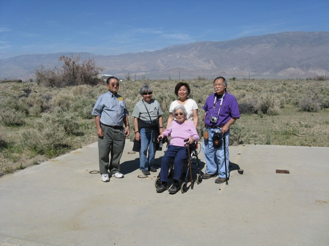 Current and former Japanese American residents from Bainbridge Island stand on the remnants of Block 3 at the Manzanar National Historic Site, where they and their families were incarcerated during WWII, April 15, 2011  L-R: Ted Kitayama, Lilly Kodama, Natalie Hayashida Ong, Fumiko Hayashida (seated), Frank Kitamoto. (OWWCC 2011) �