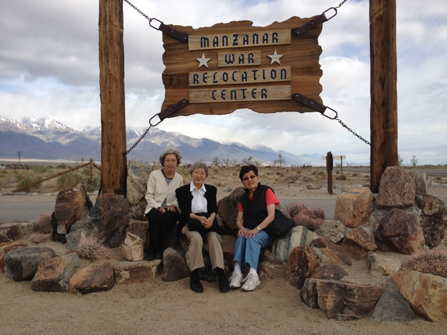 Three of the 7ups posing in front of the entrance to Manzanar. (Photo Credit: J. Garfunkel)�