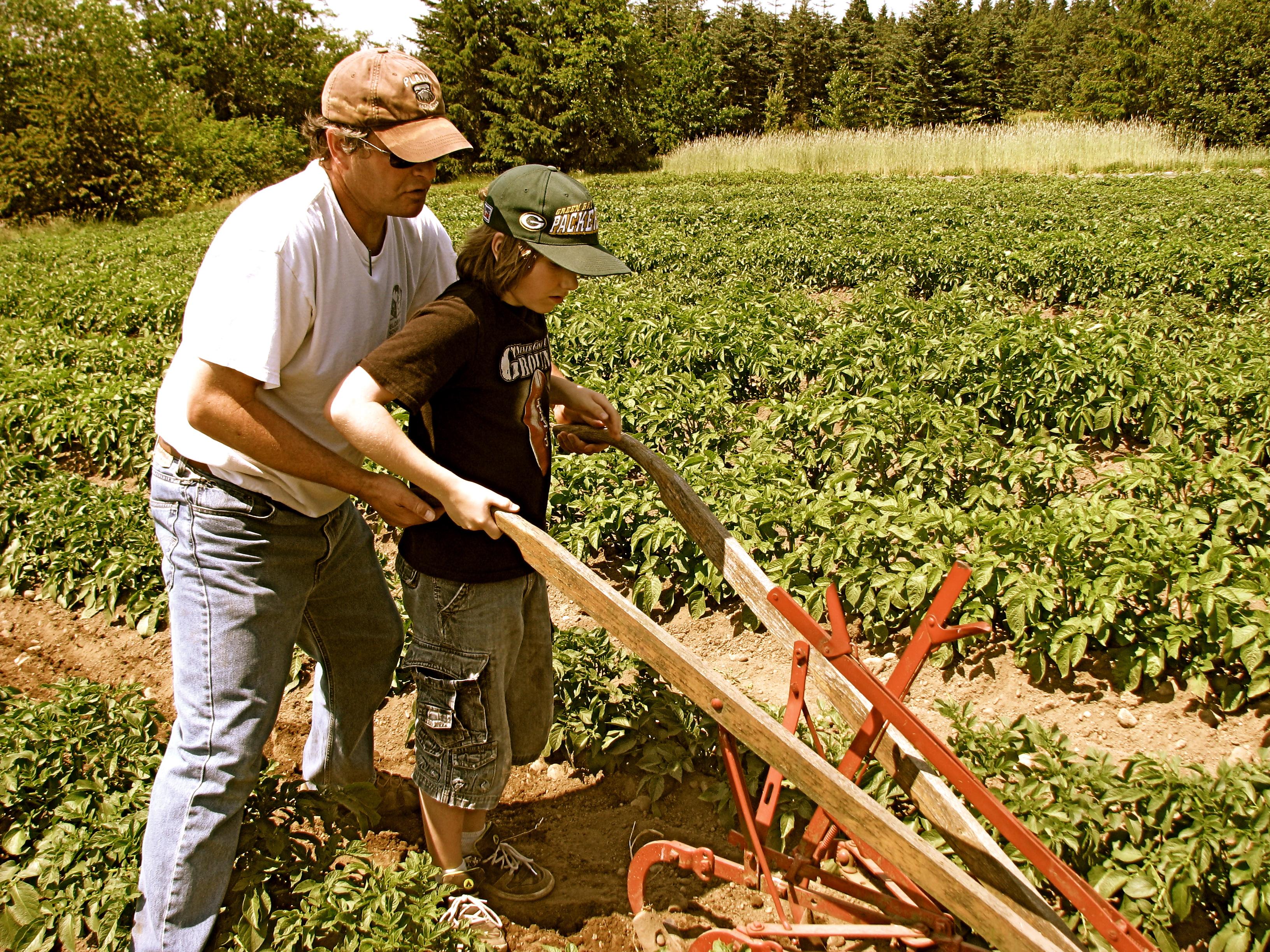 Jon & Student Plowing