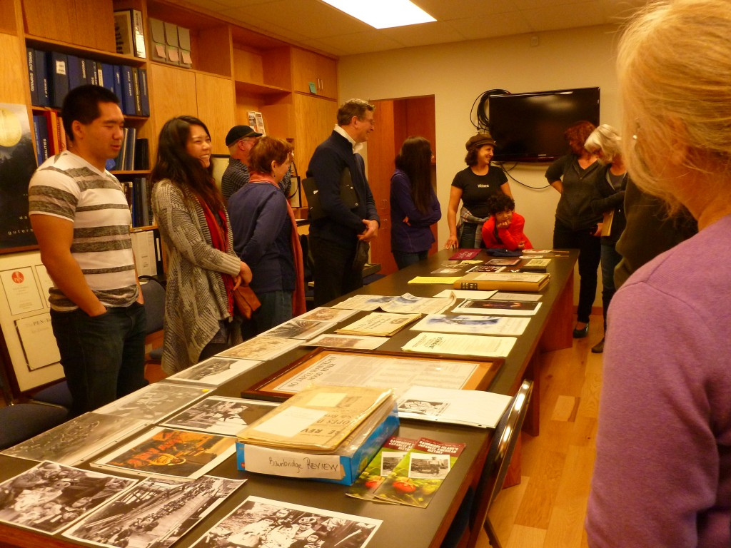 Cast members discuss the story and look over related artifacts at the Bainbridge Island Historical Museum.